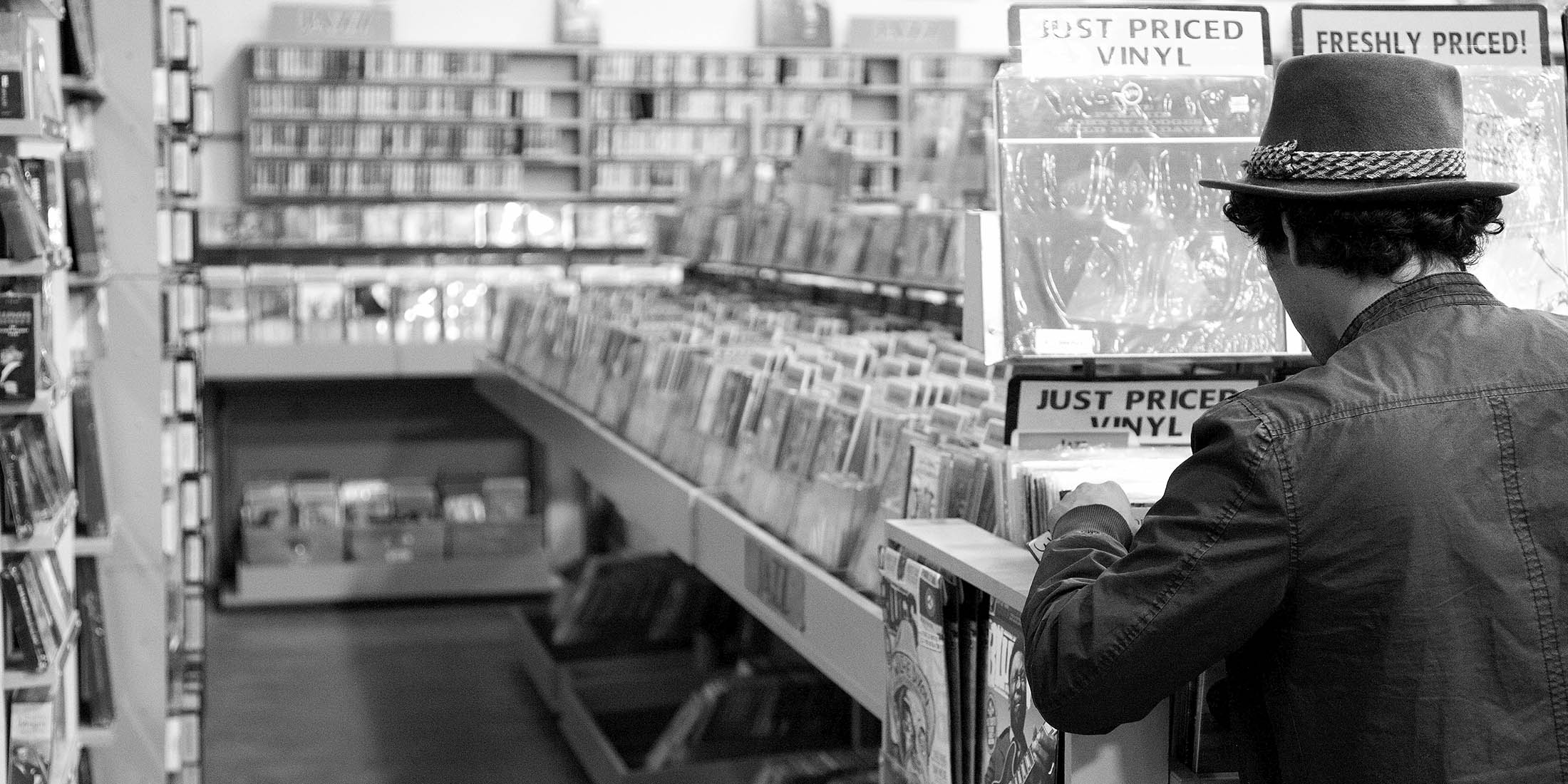 Man Looking Through Records at Record Store